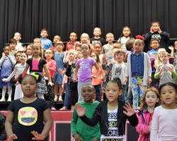 FIRST GRADE PERFORMS AT DONUTS FOR DADS!