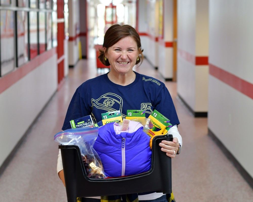 Ms. Teakell is pictured with donations from Black Dog Crossfit.